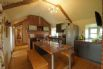 Dining area is built into the kitchen unit with wooden top and bench seating.