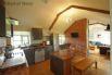 Modern kitchen in a rustic environment: brick wall, original A frames & wooden floors