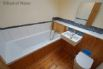 Family bathroom with bath and shower attachments, modern toilet and basin