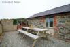 Patio area with great views, garden furniture and barbecue.
