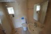 Wet room with a shower, toilet and basin.