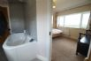 Ensuite bathroom includes a freestanding bath and hand held shower