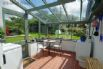 A separate sun room adjoins the kitchen and leads out to the garden.