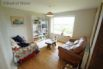 Lounge area with comfortable seating, freeview TV and amazing views