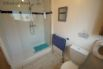 Ground floor shower room with a double shower, WC and basin.