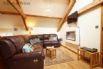 Comfortable, luxury seating, modern electric fire and plasma TV wall