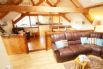 Upstairs living at Llofft Madrun. Includes living and dining areas & kitchen