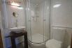 Ground floor en-suite includes a shower cubicle and heated towel rail