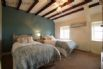 Beautiful, beamed twin bedroom with views towards the sea