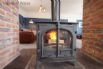 Double fronted woodburner that can be enjoyed from the kitchen and sitting room