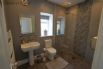 Wet room style shower room with heated towel rail and hand dryer
