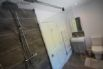 Ground floor ensuite shower room with wet room style shower and towel rail.