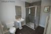 Shower room with large shower cubicle and heated towel rail