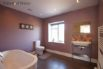 Large bathroom with lovely modern freestanding bath