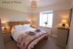 Bedroom 3 - Oak double bed and and view of Rhiw mountain