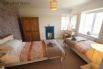 Bedroom 4 - Twin beds and exposed red brick wall and tiled fireplace