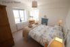 Bedroom 5 - Lovely room with a king size iron bed and oak furniture