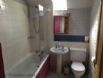 Couthie bathroom showing shower over bath