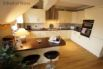 as well as a microwave, electric fan oven and hob