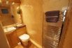 Ensuite with shower, toilet, wash basin and heated towel rail.