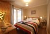 Bedroom 1 (ground floor) - inviting double bed and access to the front patio.