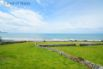Walking distance to a beautiful sandy beach at the bottom of this field