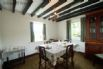 Separate dining room enjoying views over the garden towards the sea