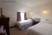 One of two twin bedrooms, also with a sea view