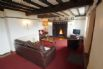 Beautiful, beamed living room with an impressive inglenook fireplace