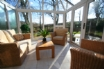 Sunny, bright conservatory leads to rear garden...