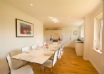 Modern dining area comfortably seats 10