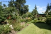 Holiday Cottage with lawns, shared play area & large trampoline.