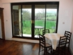 Kitchen/diner with full length balcony at this luxury country cottage