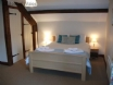 Spacious bedroom with king size bed with an en-suite shower room