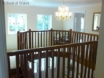 Large gallery landing with feature spotlights & mahogany stairs