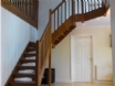 Large gallery hallway with feature spotlights & mahogany stairs