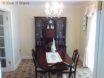 Formal, mahogany dining room with table, 4-8 chairs and patio doors