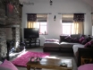 Large, quirky lounge with woodburner at Hen Efail holiday cottage