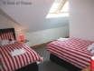 Twin room with two comfy single beds and bedroom furniture