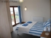 Beautiful double bedroom with patio doors leading to balcony