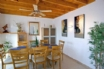 The dining room from the lounge archway, has patio doors to the garden and pool