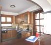 Lovely kitchen with large fridge freezer and door to outside dining area