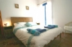 Double bedroom with ensuite and doors to a viewing gallery
