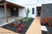 The contemporary Casa Rossi  electric gated front garden with car port