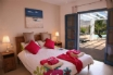 A fabulous stylish master bedroom, with patio doors to the garden