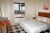 The delightful double bedroom, with air conditioning and incredible views