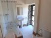 Bathroom includes bath with overhead shower & heated towel rail