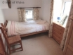 Llety'r Wennol holiday cottage - bedroom with farm yard view