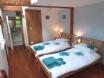 Ground floor en-suite twin bedroom at Stone Barn Cottage