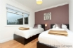 Twin bedroom tastefully furnished